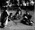 Boys gathering grass for fuel.jpg