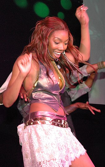 Norwood performing in a concert in July 2004 BrandyNorwoodJuly04.jpg