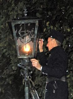 Lamplighter person employed to light and maintain street lights