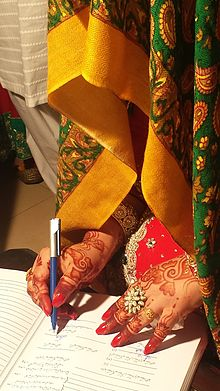 Bride signing marriage papers.jpg