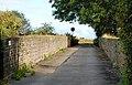 Bridge over disused railway near Lairhillock mobile home park - geograph.org.uk - 1417960.jpg
