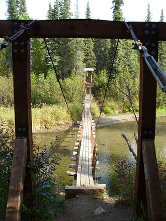 Simple suspension bridge - Crossing a stream, Denali State Park, Alaska. The design limits the impact of the trail on the important salmon migrations in the stream.