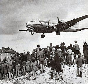 Berlin Blockade - Berliners watch a Douglas C-54 Skymaster land at Tempelhof Airport, 1948