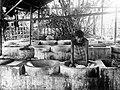 COLLECTIE TROPENMUSEUM Batik-werkplaats in Pekalongan waar de stof gekneed wordt in cementen bakken TMnr 10014218.jpg