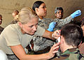 Captain Nicole Benavides applies make up to CAP cadet.jpg