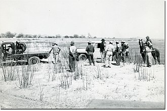 1950s Texas drought - Car towed after getting stuck in a completely dry Texas river bed.