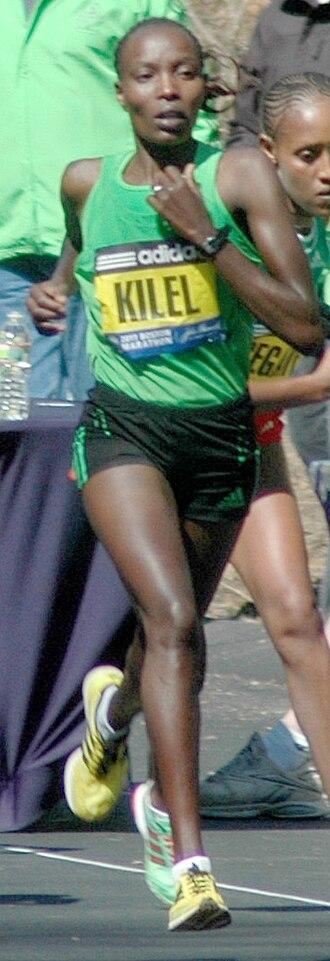 Caroline Kilel - Kilel on the way to winning the 2011 Boston Marathon, near halfway point in Wellesley