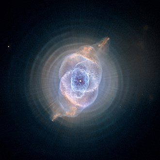 Cat's Eye Nebula - Image of NGC 6543 processed to reveal the concentric rings surrounding the inner core. Also visible are the linear structures, possibly caused by precessing jets from a binary central star system.