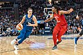 Cecilia Zandalasini (9) dribbles the ball as she's guarded by Myisha Hines-Allen (2).jpg