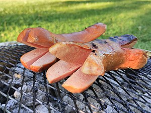 Cervelat - A grilled cervelat with its ends cut open in the traditional Swiss manner