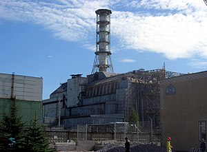 Chernobyl Nuclear Power Plant sarcophagus - The sarcophagus in 2006. The tall chimney is an original part of the reactor building.