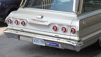 "Bumper sticker - A car displaying an ""Obama '08"" bumper sticker alongside its license plate"