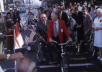 Cycling in Chicago - Former Mayor Richard J. Daley riding a Schwinn tandem with cycling advocate Keith Kingbay at the opening celebration of Clark Street bike lane.