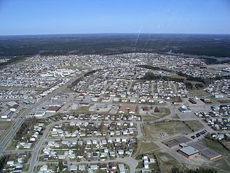 Thompson, Manitoba - City of Thompson, looking West.  The Burntwood River is visible at the edge of town.