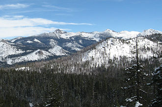 Clark Range (California) - The range from the west, January 2008. Prominent peaks, from left to right, are Mount Clark, Gray Peak, and Red Peak; the bump on Clark's left side is Quartzite Peak.