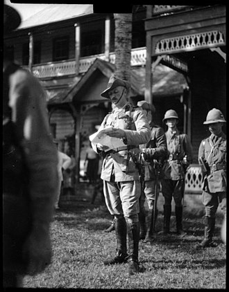 Occupation of German Samoa - Colonel Robert Logan reading a proclamation in Apia, Samoa, on 30 August 1914, the day he assumed responsibility as military administrator.