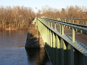 Knowlton Township, New Jersey -  The Portland-Columbia Pedestrian Bridge replaced the last of the covered bridges spanning the Delaware River in this photo facing towards New Jersey.  The original covered bridge was destroyed by the remnants of Hurricane Diane on August 19, 1955, a storm that caused record flooding throughout the region, but particularly within the watershed of the Delaware.