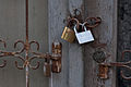 Couple of metallic padlocks on old door frame (4268291295).jpg