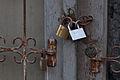Couple of metallic padlocks on old door frame (4268291295).jpg