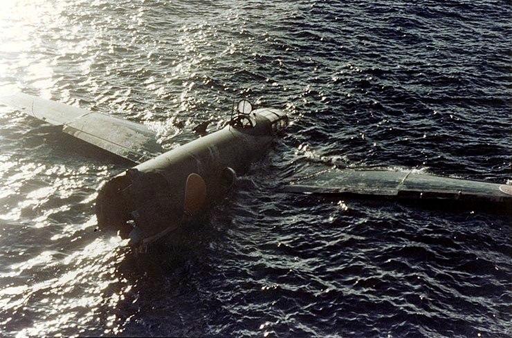 Crashed Mitsubishi G4M floating off Tulagi on 8 August 1942 (80-G-K-383)