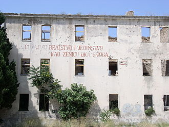 "Brotherhood and unity - ""Let us protect brotherhood and unity like the pupil of our eye"", inscription on a building in Mostar destroyed during the Yugoslav Wars."