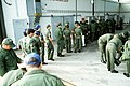DF-ST-83-07412 Air Force personnel wait in an in-processing line at Leck Air Base to begin their participation in Reforger 82.jpeg