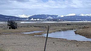 Rabbit Ears Range - Cattle ramp outside Rand, Colorado looking south from Jackson County Road 27, with Rabbit Ears Range in the background. (April 4, 2005)