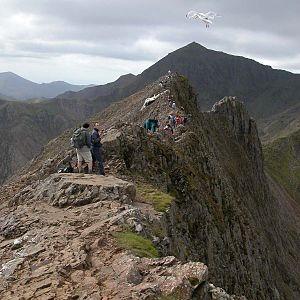 Crib Goch - The 'knife-edge' arête of Crib Goch (foreground) and the pyramidal peak of Snowdon (background) are both the result of glaciation.