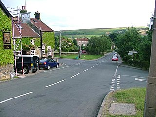 village and civil parish in Scarborough, North Yorkshire, England
