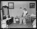 Daughter of Luther Nixon ironing. He owns his own farm. He works on Paul Reese Coal Company, Lease, Le Flore County... - NARA - 540654.tif