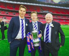 David Sharpe, Paul Sharpe and David Whelan holding FA cup.png