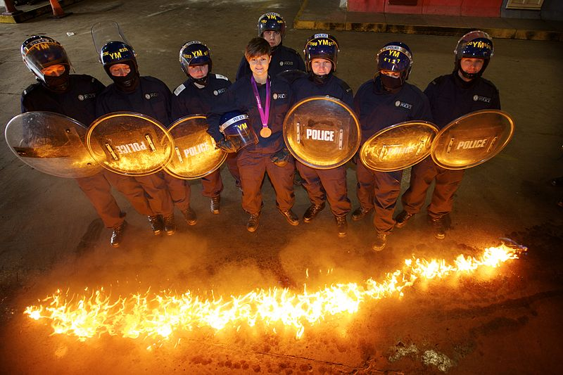 File:Day 67 - Olympian swaps her hockey stick for a police shield (8538548533).jpg