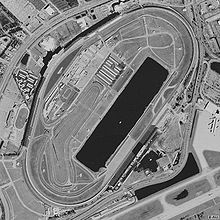 Aerial view of the Daytona International Speedway with Lake Lloyd toward the center.