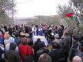 Deelnemers-aan-een-demonstratieve-eucharistieviering-in-de-open-lucht-bij-cremisan-in-het-bethlehem-district-waar-de-muur-de-plaatselijke-christelijke-gemeenschap-in-tween-zal-splitsen-kerstmis-2011-1373175748.jpg