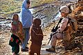 Defense.gov News Photo 111206-M-GF563-148 - U.S. Marine Corps Cpl. Brandy Bates stops to talk with Afghan children during a foot patrol through Tughay village in the Sangin district of.jpg