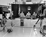 Deke Slayton (on stool at left), Buzz Aldrin, Neil Armstrong, and Michael Collins during the last pre-flight press conference.jpg