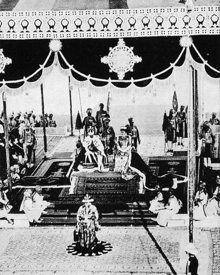 George V, Emperor of India, and Empress Mary at the Delhi Durbar, 1911. Delhi durbar 1911 2.jpg