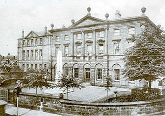 Derby School - The school at St Helen's House, with the Old Derbeians' war memorial. St Helen's House is on the right and the Pearson Building, known mainly as 'B' block on the left