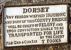 "Sign headed ""DORSET"" and saying ""Any person willfully INJURING any part of this COUNTY BRIDGE will be guilty of FELONY and upon conviction liable to be TRANSPORTED FOR LIFE by the court."""