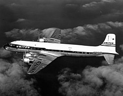 Douglas DC-7 N6301C flight.jpg
