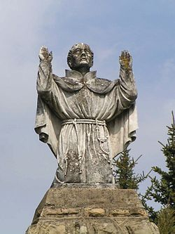 Dukla - statue St. John of Dukla on the courtyard in front of the church of the Bernardine Fathers.jpg
