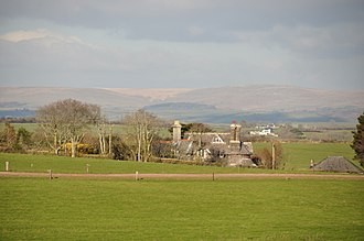 Membland - Eastern Lodge, a former gatehouse to Membland, with Dartmoor beyond