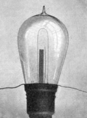 Thermionic emission - One of the bulbs with which Edison discovered thermionic emission. It consists of an evacuated glass light bulb containing a carbon filament (hairpin shape), with an additional metal plate attached to wires emerging from the base.  Electrons released by the filament were attracted to the plate when it had a positive voltage.