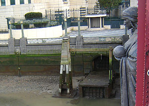 River Effra - Diverted overflow outlet of the River Effra into the Thames, by Vauxhall Bridge, beneath Alfred Drury's sculpture of Science