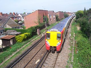 A suburban electric railway line in England, linking London Waterloo and Reading