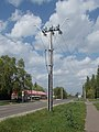 Electricity pylon and automobile dealership, Route 31, 2019 Heves.jpg