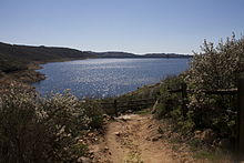 This is a photo of the Olivenhain dam & reservoir, which is located within the Elfin Forest Recreational Reserve. It is visible from part of the 11 miles of hiking that the reserve offers.