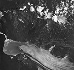 Ellsworth Glacier, terminus of valley glacier, wide lateral moraines, and hanging glaciers on nearby peaks, August 27, 1963 (GLACIERS 6487).jpg