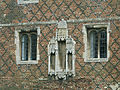 Ely - The Bishop's Palace - detail of diapering, and statue niches.JPG