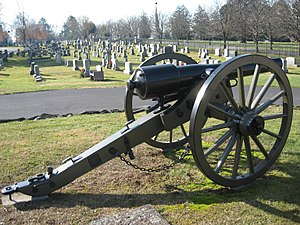 Evergreen Cemetery (Adams County, Pennsylvania) - Ginnie Wade Monument, location of platform for Gettysburg Address and Soldiers National Monument (L to R) are marked on the horizon. The oldest section (A) of the cemetery appears behind the Parrott rifled cannon.